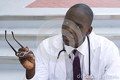 African American doctor gesturing outside