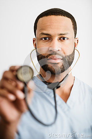 African American Doctor Holding Up A Stethoscope