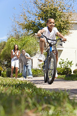 African American Family Boy Riding Bike & Parents