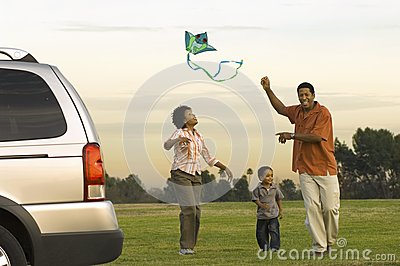 African American Family Flying Kite