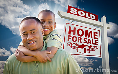African American Family in Front of Sold Home Sign
