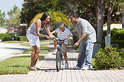African American Family Parents & Boy Riding Bike