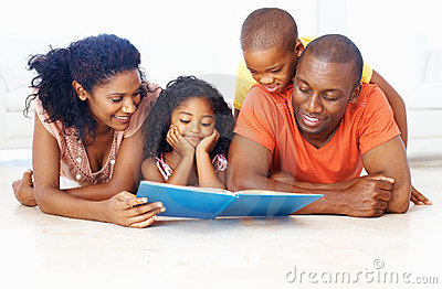 African American family reading book together
