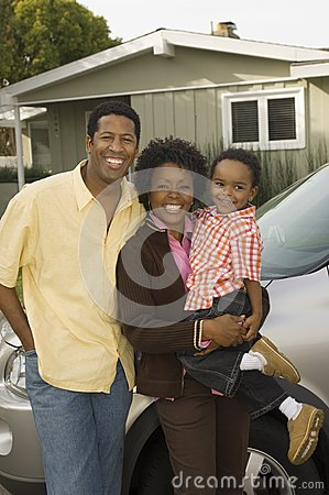 African American Family Standing By Car