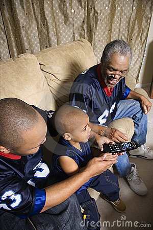 Free African-American Family Watching Tv With Boy Holding Remote. Royalty Free Stock Images - 2037039