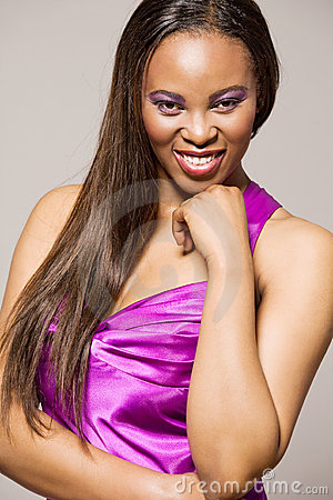 African-american fashion model in purple dress.