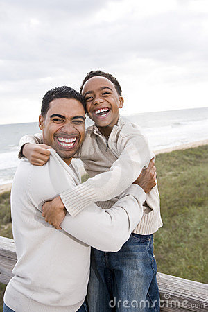 African-American Father And Son Laughing At Beach Royalty ... Hispanic Family Exercise