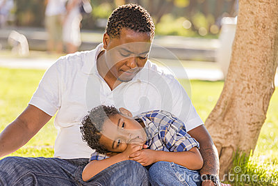 African American Father Worried About His Son