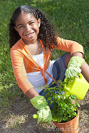 African American Girl Child Gardening with Flowers