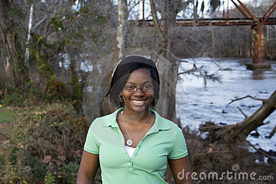 African American girl in front of river