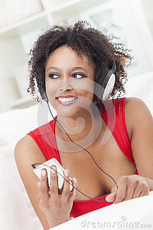 African American Girl Listening to Music at Home