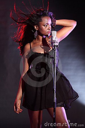 Free African American Girl Singing On Stage Royalty Free Stock Photography - 19184917