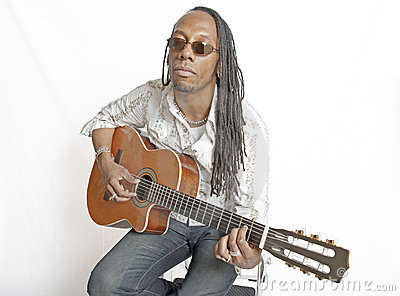 African American guitarist seated