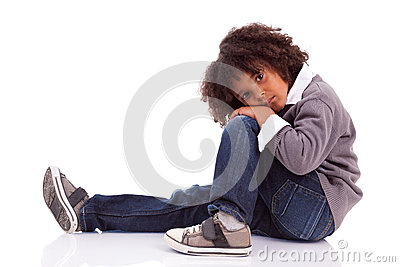 African american little boy sitting on the floor