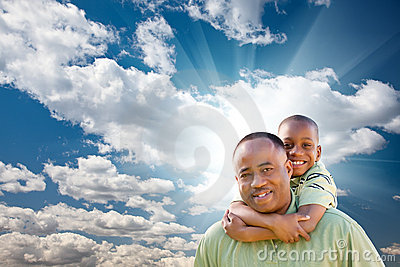 African American Man with Child Over Sky