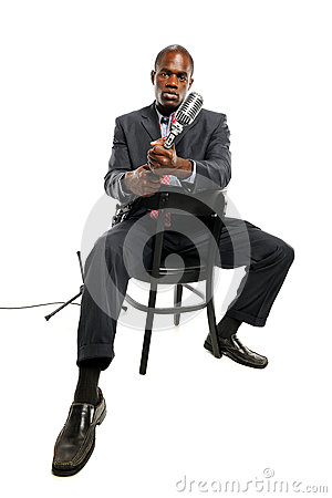 African American Man holding a vintage microphone