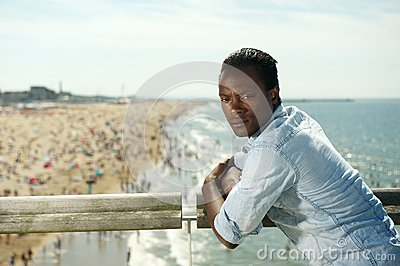African american man relaxing at the beach on a summer day
