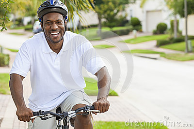 African American Man Riding Bicycle