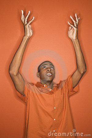 Free African-American Man Throwing His Arms Up In The Air. Stock Photo - 2043870