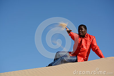 African American man throwing sand