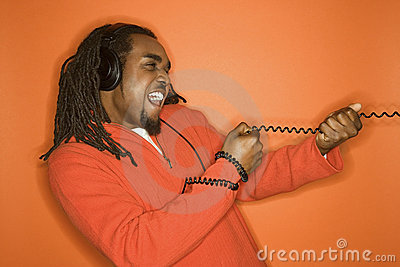 African-American man wearing headphones.
