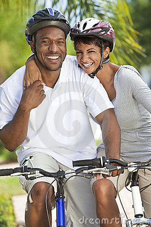 Free African American Man & Woman Couple Cycling Stock Image - 20956981