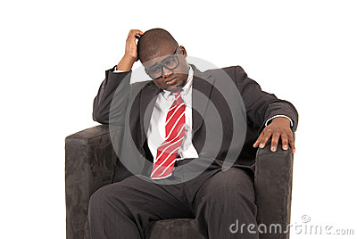 African American model in business suit looking down