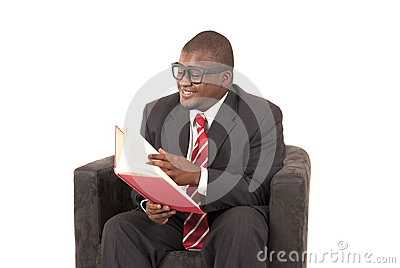 African American model in gray business suit laughing while reading