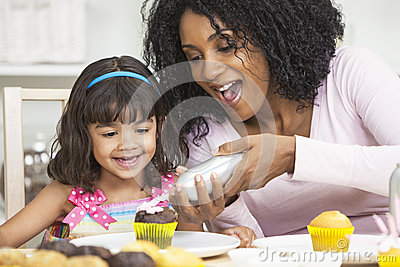 African American Mother Daughter Icing Cakes