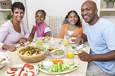 African American Parents Children Family Eating At Dining Table