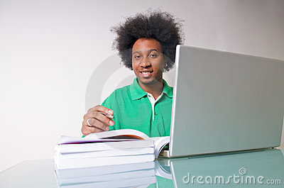 African American studying with laptop
