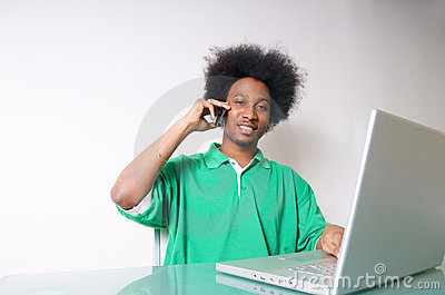 African American talking with laptop