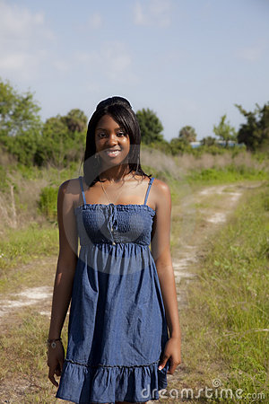 African American teen on country road
