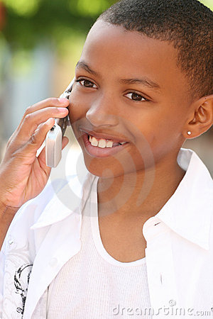 African American Teenager Boy on Cell Phone