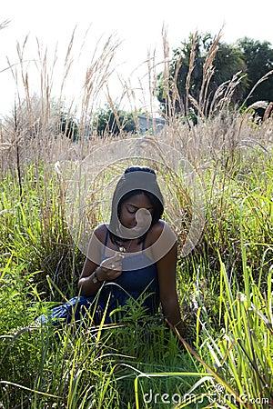 African American teenager in field