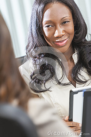 African American Woman or Businesswoman in Meeting