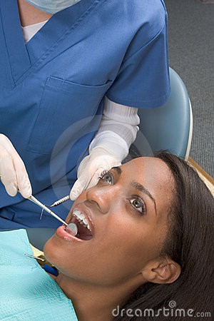 African-American woman and Caucasian dentist