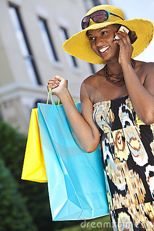African American Woman, Cell Phone & Shopping Bags