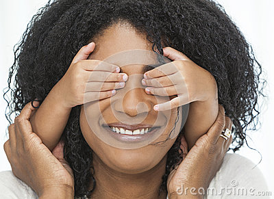 African American Woman Child with Hands Over Eyes