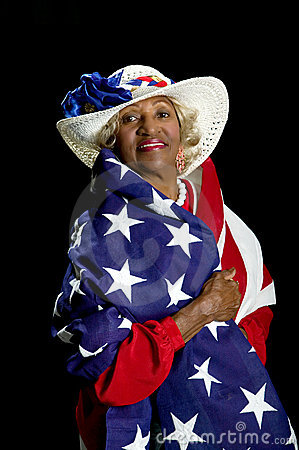 African-American woman draped in an American flag.