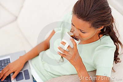 An African American woman drinking coffee