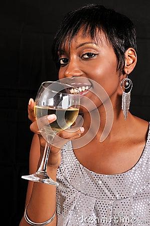 African American Woman Enjoying Wine Royalty Free Stock