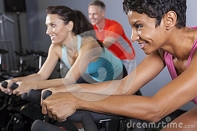 African American Woman on Exercise Bike at Gym