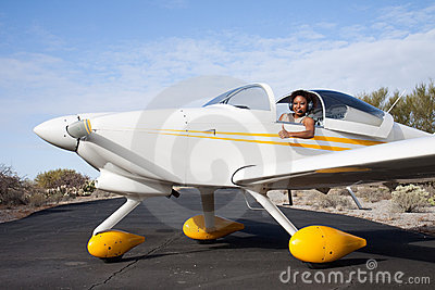 African American woman flying a private plane