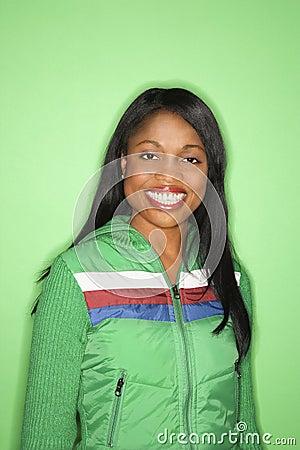 African-American woman in green coat.