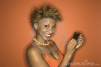 African-American woman holding pda.