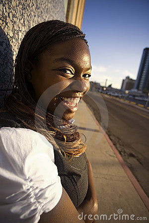 Free African American Woman Leaning Against A Building Stock Photos - 6725793