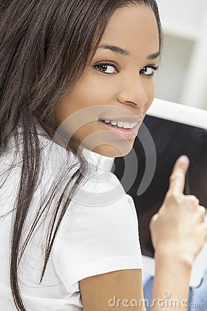 African American Woman on Tablet Computer At Home