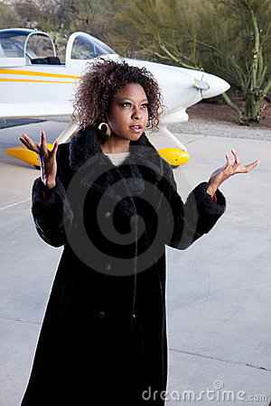 African American woman waiting at the airport