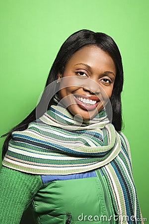 African-American woman wearing green scarf.